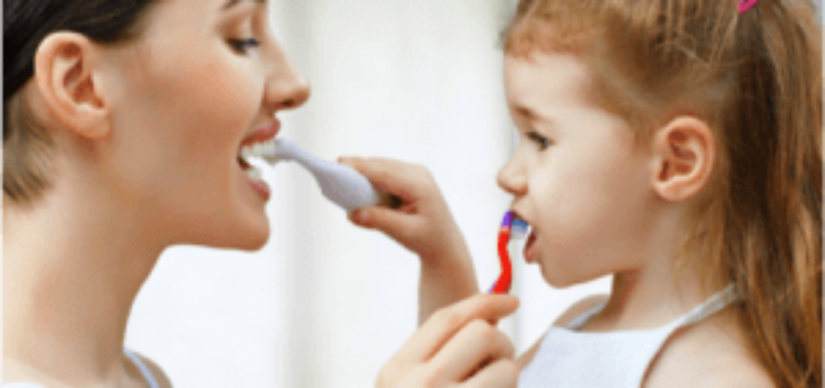 Mom and Child Brushing Teeth Together
