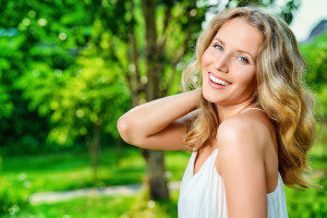 Outdoor portrait of gorgeous blonde woman smiling.