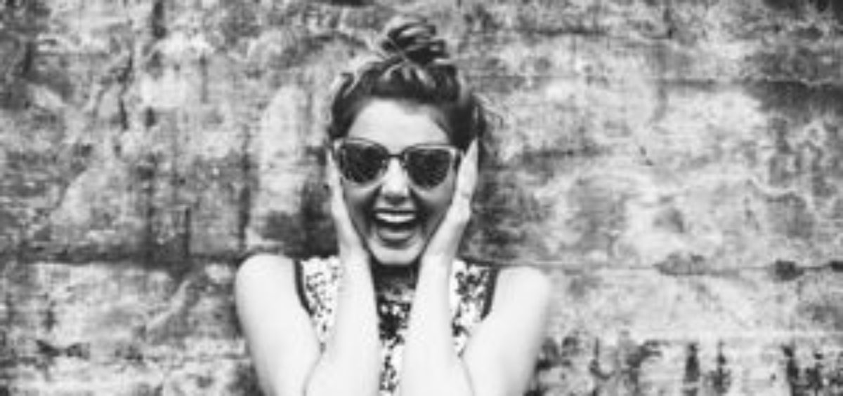 Black and White Retro Portrait of Young Woman Laughing