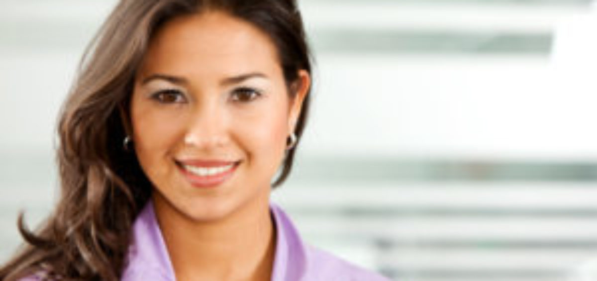 Business Woman Smiling At You In Office