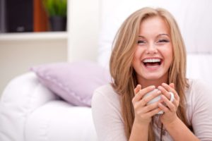 Woman Laughing with Tea and Beautiful Teeth