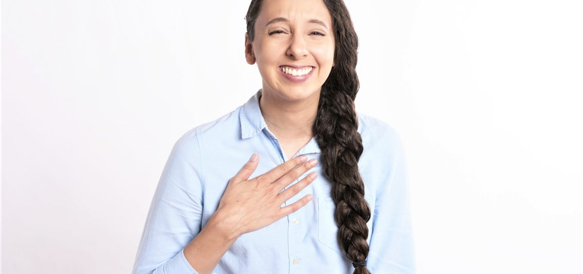 Woman smiling big with hand on heart
