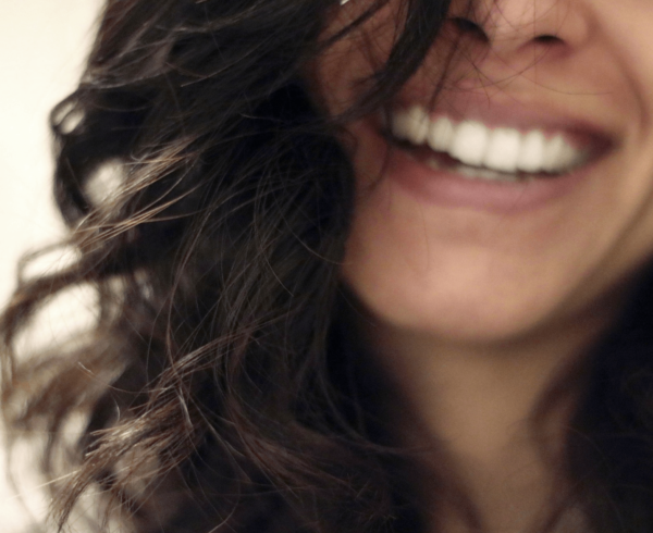 Woman's smile out of focus