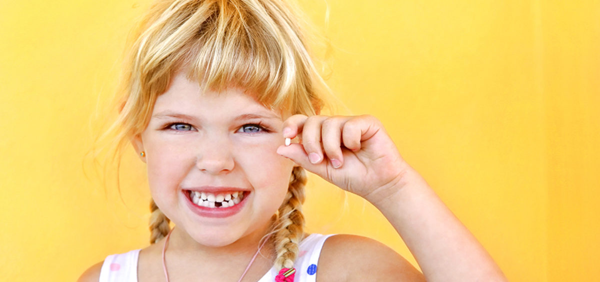 Child holding a tooth